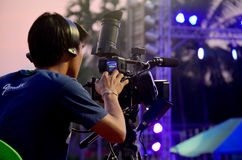 Thai people working use Digital Camcorder Video for broadcast li. Ve Phu thai world day festival at Ban Non Hom on January 15, 2016 in Sakon Nakhon, Thailand stock photography