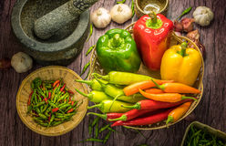 Thai pepper and Capsicum annuum in basket. Green and Red Capsicum Bell Pepper on wooden background.Thai pepper and Capsicum annuum in basket Royalty Free Stock Photo