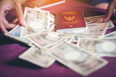 Thai personal passport for tourist go to japan. prepare Japanese. Currency 10000 Yen banknote for travel and Japanese economy concept. exchange from thai baht royalty free stock photos