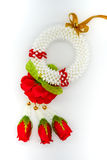 Thai plastic garland decorated with fabric red rose isolated on. White background for buddhist respect. Top view Stock Image