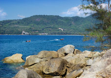Thai pleasure boating on a calm sea bay Royalty Free Stock Image