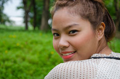 Thai Plump Girl is Happy among nature Royalty Free Stock Photo