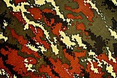 Thai police green tiger stripe camouflage fabric Stock Photos