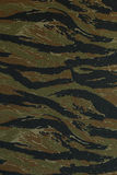 Thai police green tigerstripe camouflage fabric Royalty Free Stock Image