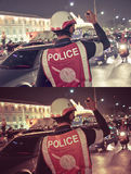 Thai police is working in the night in crowded of Bangkok Royalty Free Stock Photography
