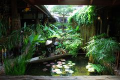 Thai Pool Garden. A pool garden from a park which also includes thai restaurants on sides Royalty Free Stock Photography