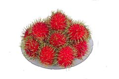 Red rambutan are edible in the serving dish. Thai popular fruit ,Red rambutan are edible in the serving dish Stock Photo