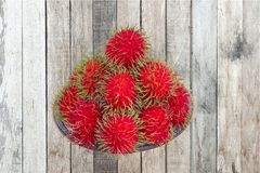 Red rambutan are edible in the serving dish. Thai popular fruit ,Red rambutan are edible in the serving dish Royalty Free Stock Photos