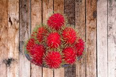 Red rambutan are edible in the serving dish. Thai popular fruit ,Red rambutan are edible in the serving dish Royalty Free Stock Images