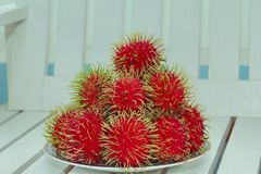 Red rambutan are edible in the serving dish. Thai popular fruit ,Red rambutan are edible in the serving dish Stock Photos