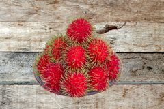 Red rambutan are edible in the serving dish. Thai popular fruit ,Red rambutan are edible in the serving dish Stock Image
