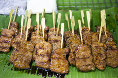 Thai Pork Satay Moo Yang. Thai grilled pork satay called Moo Yang is a popular street food snack Royalty Free Stock Photography