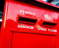 Red Thai Postbox with Destination Texts in English and Thai Stock Images