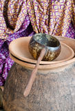 Thai pottery drinking water pitcher and coconut shell la Royalty Free Stock Photography