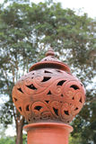 Thai pottery lamp. S are decor on the poles.This folk artwork is common apparent in Thailand Stock Image