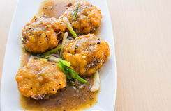 Thai prawn cakes in gravy. Thai prawn cakes in black pepper gravy Royalty Free Stock Image