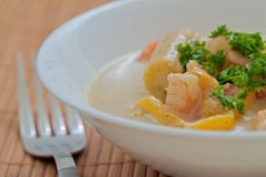 Thai Prawn Curry. Green Thai curry with prawn, baby corn and pepper, close up royalty free stock image