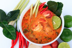 Thai Prawn Soup with Lemongrass (Tom Yum Goong) On Brown Cloth Background. Tom Yum Goong, the Thai style hot and sour prawn soup Stock Image