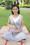 Thai Pregnant mom Was listening to music in the garden. Royalty Free Stock Photography