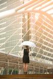 Thai pretty woman in black dress holding transparent umbrella. Royalty Free Stock Photos
