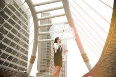 Thai pretty woman in black dress holding transparent umbrella. Royalty Free Stock Images