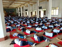 Thai primary school students lie down quietly on the floor stock photo