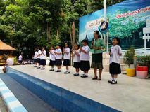 Thai primary school students in morning ceremony royalty free stock photo