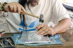The Thai professional handicraft do his relief artwork. Stock Photo