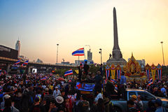 Thai protesters gather at Victory monument during twilight sky Royalty Free Stock Photo