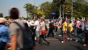 Thai protesters motionally walk to Government House Royalty Free Stock Image