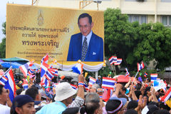 Thai protesters pass King Bhumibol billboard Royalty Free Stock Image