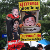 Thai protesters raise anti amnesty bill plates Stock Photography