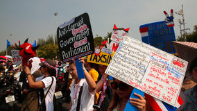 Thai protesters raise anti government plates Stock Photo