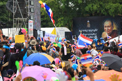 Thai protesters raise fake clap hands and Thai flags Royalty Free Stock Image