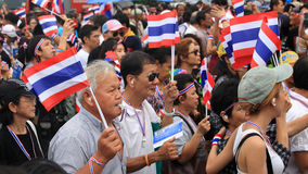 Thai protesters raise thai flag and blow whistles Stock Image