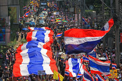 Thai protestors rally with large thai flag Royalty Free Stock Images