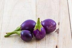 Thai purple eggplants or purple small brinjal. Stock Photo