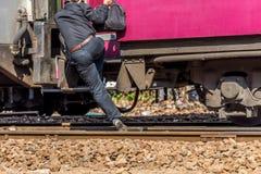 Thai railway train people step up Stock Photo