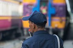 Thai railway train with Security man Royalty Free Stock Image