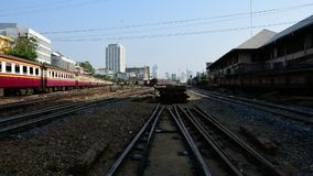 Thai railway train, Timelapse. Bangkok, Thailand - April 25, 2016 : Unidentified railway train on the railroad tracks in Bangkok station. Many people in Thailand stock video footage