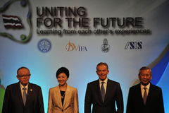 Thai Reconciliation Forum. Thai Prime Minister Yingluck Shinawatra (2nd L) poses for photographs with former British Prime Minister Tony Blair (2nd R) and Nobel Royalty Free Stock Photo