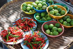 Thai red chilli and lemon. Thai red chilli and green lemon are famous food ingredient for mostly Thai culinary Stock Photos