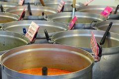 Thai red curry in big pot. Thai red curry selling in the big pot in the market Stock Photo