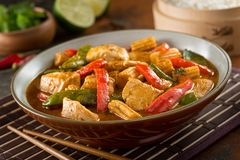 Thai Red Curry with Chicken. Delicious homemade thai red curry with chicken, red pepper, snow peas, baby corn, coconut milk and cilantro Royalty Free Stock Photography