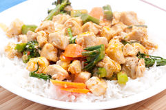Thai red curry chicken. With white rice and vegetables royalty free stock images