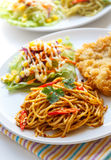 Thai red curry  spaghetti with fried fish. Stock Photography