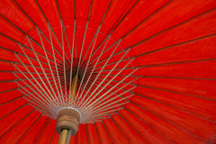Thai red umbrella close up. Texture background Royalty Free Stock Images