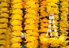 Thai religion yellow flower garland. Texture background stock photography