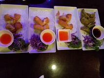 Thai restaurant serving asian food. With vegetable spring roll, dumplings and sauce stock photography
