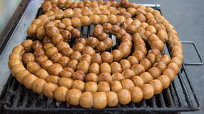 Thai rice ball sausage grill on the coal  stove Royalty Free Stock Photo